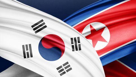 Photo illustration of North Korea and South Korea flags.
