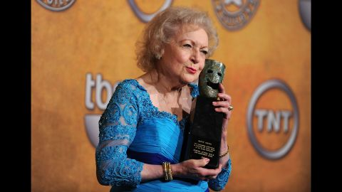 """White clutches her Life Achievement Award at the Screen Actors Guild Awards in 2010. """"I am the luckiest old broad on two feet,"""" <a href=""""http://www.cnn.com/2017/02/09/entertainment/betty-white-brooke-baldwin-history-of-comedy-cnntv/index.html"""">she told CNN's Brooke Baldwin in 2017.</a> """"I'm still able to get a job, at this age. I will go to my grave saying, 'Can I come in and read for that tomorrow?' """""""