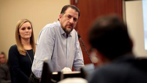 Gwen Anderson listens as her former gymnastics coach, Tom Brennan, addresses Larry Nassar at Nassar's sentencing hearing Wednesday.