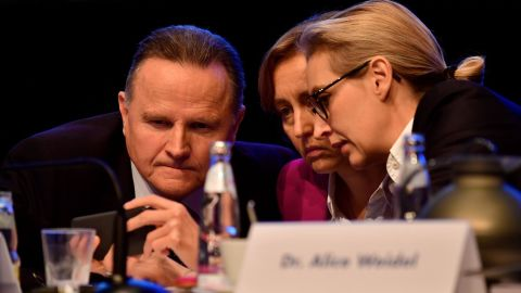 Alternative for Germany leader Alice Weidel (right) chats with two party members during the party congress on December 2 in Hanover, Germany.
