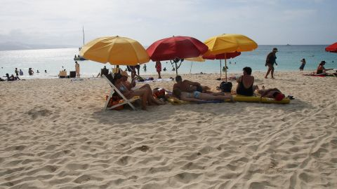A 2007 image shows tourists sunbathing at Doctor Cave beach in Montego Bay.