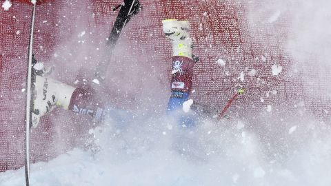 <strong>...Gone:</strong> American skier Jared Goldberg hits the safety nets on the difficult Streif run in Kitzbuhel.