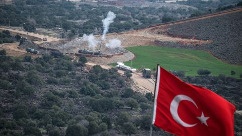 Turkish artillery shell YPG positions near the Syrian border on Sunday.