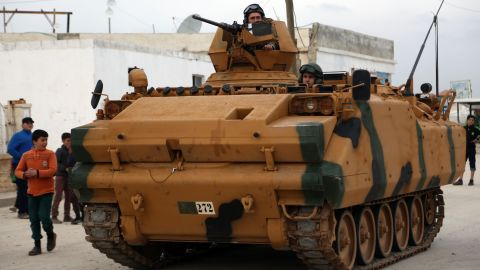 Turkish soldiers look through the hatches and turrets of an infantry fighting vehicle (IFV) as they pass through the Bab al-Salamah border crossing between Syria and Turkey in the north of Aleppo province, on January 21, 2018. Turkish troops and tanks entered northern Syria on January 21 in an offensive aimed at ousting the Kurdish Peoples' Protection Units (YPG), which Ankara considers a terror group, from the Afrin region bordering Turkey. / AFP PHOTO / Nazeer al-Khatib        (Photo credit should read NAZEER AL-KHATIB/AFP/Getty Images)