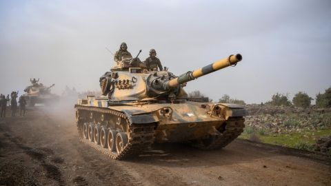 """Turkish army tanks enter Afrin, an enclave in northern Syria controlled by U.S.-allied Kurdish fighters, in Hassa, Hatay, Turkey, Monday, Jan. 22, 2018. Turkey's President Recep Tayyip Erdogan has said his country will """"not take a step back"""" from its military operation on Afrin. Speaking in Ankara on Monday_the third day of the operation— Erdogan said Turkey's """"fundamental goal"""" is ensuring national security, preserving Syria's territorial integrity and protecting the Syrian people.(AP Photo)"""