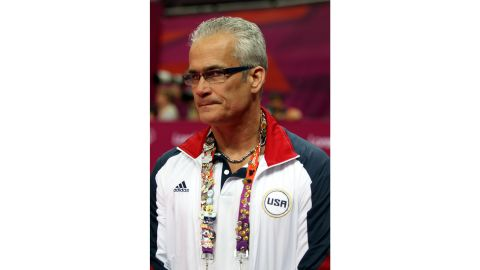 Coach John Geddert of the United States women's team wears alot of Olympic pins during the Women's Team Gymnastics competition at North Greenwich Arena, Tuesday, July 31, 2012, in London. the women defeated the russians to take the gold medal in team competition. (AP Photo/Marc Serota)