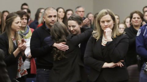 Former gymnast Rachael Denhollander, center, is hugged after giving her victim impact statement during the seventh day of Larry Nassar's sentencing hearing Wednesday, Jan. 24, 2018, in Lansing, Mich. At right is Assistant Attorney General Angela Povilaitis. Nassar has admitted sexually assaulting athletes when he was employed by Michigan State University and USA Gymnastics, which is the sport's national governing organization and trains Olympians.