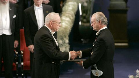 """<a href=""""https://www.nobelprize.org/nobel_prizes/physics/laureates/2005/hall-facts.html"""" target=""""_blank"""" target=""""_blank"""">2005 Nobel Prize in Physics</a> recipient (left) participated in 1952. He was one of four people in 2005 awarded a Nobel Prize for developing laser-based precision spectroscopy, including """"the optical comb technique"""" --  a way to measure frequencies with high precision."""