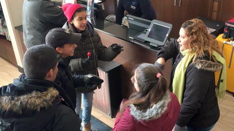 Liz Cruz, right, husband Elvin Gonzalez and her three children in the lobby of their Manhattan hotel.