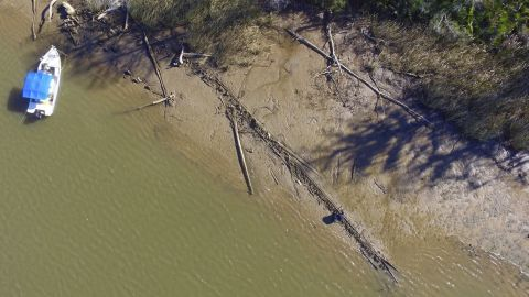 This aerial photo shows the remains of what may be the Clotilda, the last slave ship documented to have delivered captive Africans to the United States. The long spine is the ship's starboard side.