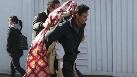 A person injured in the fire is carried to safety Friday in Miryang, South Korea.