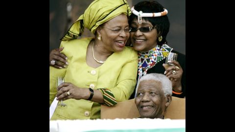 Madikizela-Mandela, right, joins her ex-husband and his third wife, Graca Machel, during his 90th birthday celebrations in Tshwane, South Africa, in 2008.