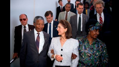 The Mandelas are welcomed by former first lady Jackie Kennedy during a visit to Boston in 1990.