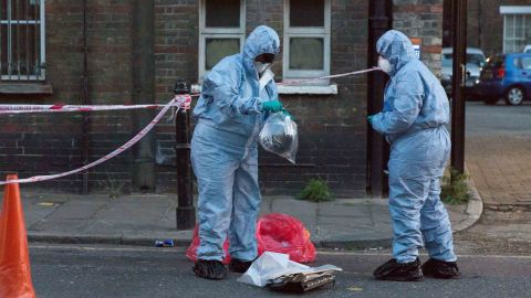 Police forensic officers at the crime scene cordon on Burnham Street just off Roman Road this evening near Singh supermarket. Two males in their late teens have been taken to hospital for treatment after an unknown liquid was thrown at them. Bethnal Green acid attack, London, UK - 25 Jul 2017 (Rex Features via AP Images)