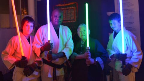 "John Ellis and Mushim Patricia Ikeda with students at a workshop based on ""Star Wars"" at the East Bay Meditation Center."