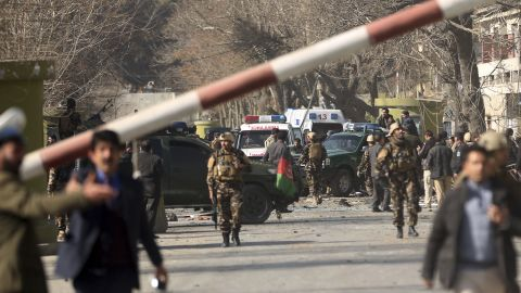 Security forces inspect the site of Saturday's attack in the center of the Afghan capital.
