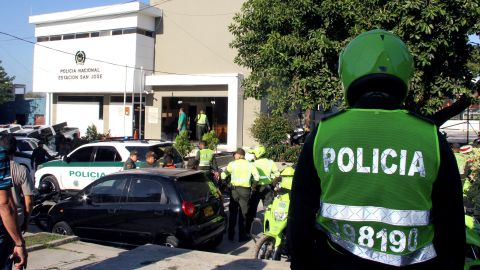 Officers are on the scene at the Barranquilla, Colombia, station house after Saturday's bombing.