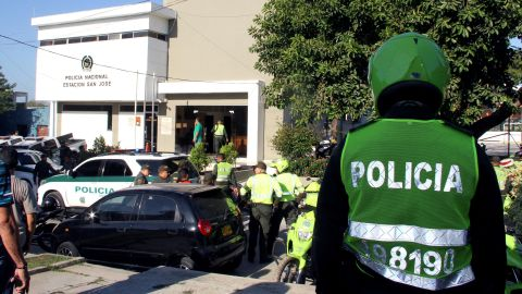 Officers arrive on the scene of a deadly bombing in Barranquilla, the day before Sunday's blast.