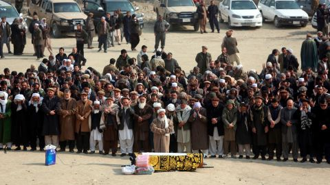 Afghans pray during the funeral of a victim who was killed in Saturday's deadly suicide attack in Kabul, Afghanistan, Sunday, Jan. 28, 2018. The deadly explosion caused by a suicide bomber driving an ambulance in the capital.