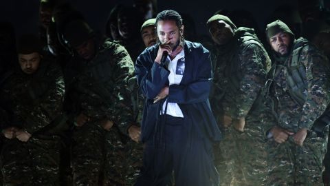 Kendrick Lamar performs at the start of the broadcast. He was nominated for seven Grammys and won five.