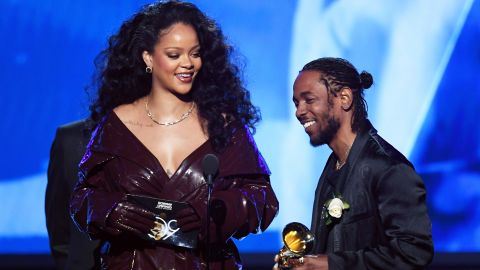 """Kendrick Lamar is joined by Rihanna as he accepts the first Grammy of the television broadcast. The two teamed up for """"Loyalty,"""" which won the award for best rap/sung performance."""