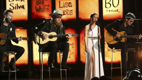 """The Brothers Osborne, left, join Maren Morris and Eric Church for a cover of the Eric Clapton classic """"Tears in Heaven."""" The song -- and the stage -- paid tribute to those killed in the Las Vegas shooting last year."""