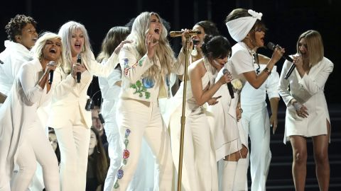 """Kesha performs """"Praying"""" as she is backed up by singers including Bebe Rexha, Cyndi Lauper, Camila Cabello, Andra Day and Julia Michaels."""
