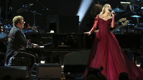 "Elton John and Miley Cyrus team up for John's ""Tiny Dancer."""