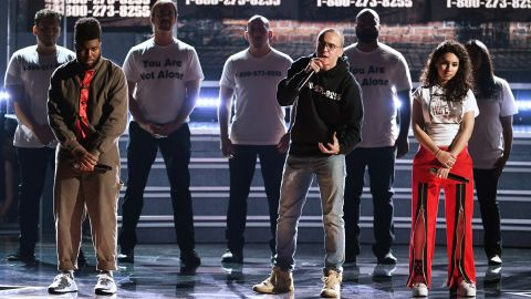 """From left, Khalid, Logic and Alessia Cara perform """"1-800-273-8255."""" The song title is the phone number of the National Suicide Prevention Lifeline."""