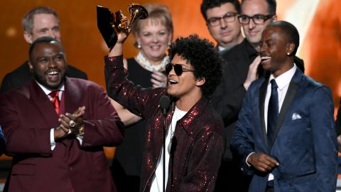 """Bruno Mars accepts the Grammy Award for album of the year, which he won for """"24K Magic"""" on Sunday, January 28. Mars also won the Grammys for song of the year (""""That's What I Like"""") and record of the year (""""24K Magic"""")."""
