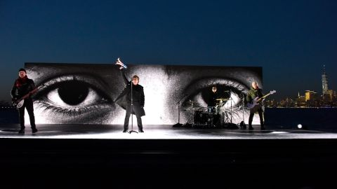 """U2 performs """"Get Out of Your Own Way"""" on a barge near the Statue of Liberty."""
