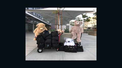 """Neighborhood volunteers in Perris, California, packed duffel bags for the Turpin children, who the volunteers dubbed the """"Magnificent 13."""""""
