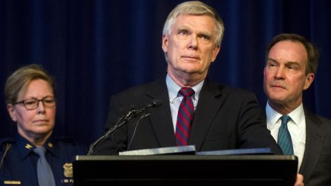 William Forsyth, a former Kent County prosecutor, speaks after Attorney General Bill Schuette, right, announced an open and ongoing investigation into the systemic issues with sexual misconduct at Michigan State University that began in 2017 on Saturday, Jan. 27, 2018 at the G. Mennen Williams Building in Lansing, Mich.  Schuette said  that the independent probe will shine a bright light on every corner of the university.    (Jake May/The Flint Journal-MLive.com via AP)