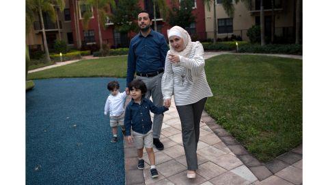 Temporary Protected Status (TPS) holders Mohammad Alala, his wife Dania both from Syria and their two U.S. born children Taim and Amr walk near their home in Miramar, Florida, U.S., January 24, 2018. REUTERS/Saul Martinez (Newscom TagID: rtrlnine511076.jpg) [Photo via Newscom]