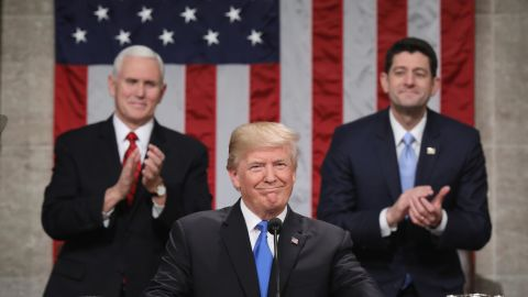 US President Donald Trump smiles after arriving to give the State of the Union address in the chamber of the US House of Representatives in Washington, DC, on January 30, 2018. / AFP PHOTO / POOL / Win McNamee        (Photo credit should read WIN MCNAMEE/AFP/Getty Images)
