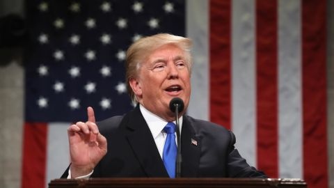 US President Donald  Trump gestures during the State of the Union address in the chamber of the US House of Representatives in Washington, DC, on January 30, 2018. / AFP PHOTO / POOL / Win McNamee        (Photo credit should read WIN MCNAMEE/AFP/Getty Images)