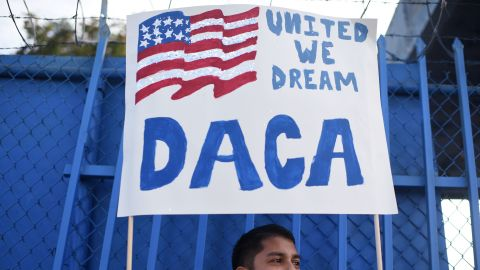 DACA recipient and appliance repair business owner Erick Marquez holds a sign during a protest in support of DACA (Deferred Action for Childhood Arrivals) which provides protection from deportation for young immigrants brought into the US illegally by their parents, September 10, 2017 in Los Angeles, California. / AFP PHOTO / Robyn Beck        (Photo credit should read ROBYN BECK/AFP/Getty Images)