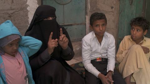 Ex-child soldier Younis, 13 (second from right), and his mother Samira speak about the boy's enduring nightmares from his time in battle.