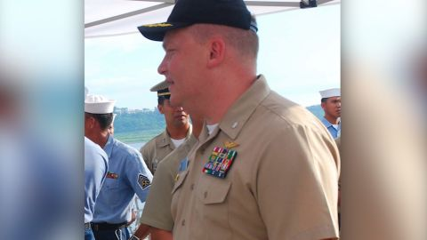 Cmdr. Troy Amundson, right, speaks with members of the Philippine navy before a closing ceremony for Cooperation Afloat Readiness and Training aboard the guided-missile destroyer USS Halsey. CARAT is a series of bilateral exercises held annually in Southeast Asia to strengthen relationships and promote maritime security.