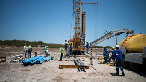 A team prepares a site where the Cape Town city council has ordered drilling into the aquifer to tap water, in Mitchells Plains, Cape Town.