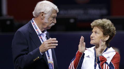 Husband and wife Bela and Martha Karolyi talk before the US women's Olympic gymnastics trials in 2012.