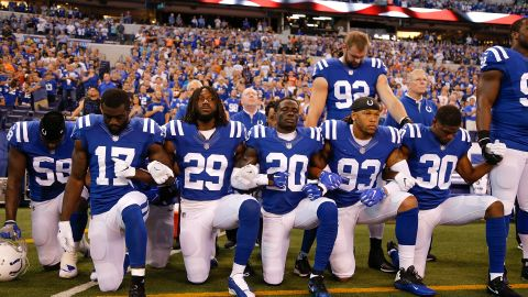 That same day, members of the Indianapolis Colts take a knee during the National Anthem ahead of their game against Cleveland Browns at Lucas Oil Stadium in Indianapolis.