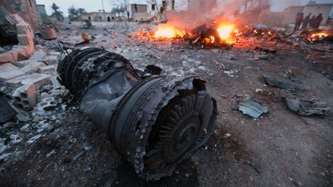 Smoke billows from the site of a downed Sukhoi-25 fighter jet in Syria's northwest province of Idlib.