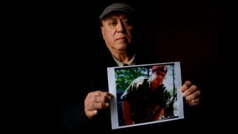 Miguel Perez holds a photo of his son, Miguel Perez Jr., on April 4, 2017 in Chicago.