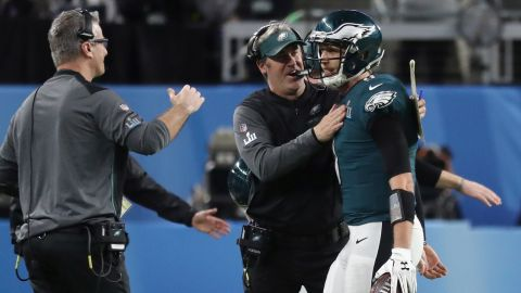 Foles is congratulated by his head coach after the quarterback caught a 1-yard touchdown late in the first half. The touchdown came on a 4th-and-goal trick play.