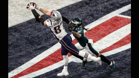 New England tight end Rob Gronkowski reaches for his second touchdown catch of the game. After the extra point, the Patriots took a 33-32 lead in the fourth quarter. It was their first and only lead of the game.