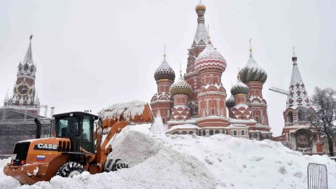 A bulldozer plows through snow in Red Square in Moscow on Sunday, February 4.