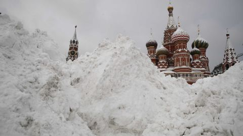 Snow blankets Red Square in Moscow on Monday, February 5, causing delayed flights and power cuts.
