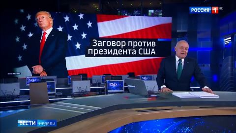"""RT anchor introduces the segment in front of a background that reads: """"A conspiracy against the president of the USA.""""  video here https://www.youtube.com/watch?v=7wlSu4nJcic 1 19 46   Kiselyov's intro:  """"Big scandal in the United States. Turns out that by the fall of 2016 a conspiracy formed against then-candidate Donald Trump in the US special services. And the efforts undermining Trump continued even after his victory. Unthinkable! Special services against the president of the country. New details of this story came to light yesterday. Valentin Bogdanov reports from the US. [goes into a package]  The package is a rehash of the Trump election, Nunes memo, Carter Page, etc., casting it as a conspiracy against Trump by American """"siloviki"""" -- the word Russians use to describe the power ministries here (security services, military, etc.). No new claims in the package, it just explains the memo, the faceoff between the FBI and Trump, etc."""