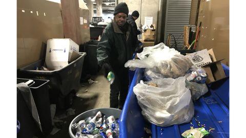 Workers sort waste at US Bank Stadium.
